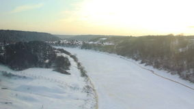 High-speed train (POV). HD 1080p: High angle View from the window of high-speed train on the frozen river, open spaces, forest and villages. The train moves on stock footage