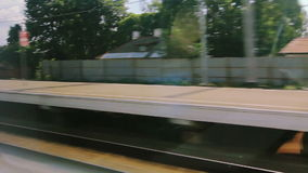 High-speed train at the railway station (POV). View from the windows of high-speed train at the railway station (POV stock footage