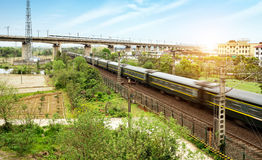 A high-speed train running on an elevated bridge. High speed trains through the bridge, dusk landscape royalty free stock images