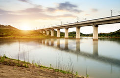 A high-speed train running on an elevated bridge. High speed trains through the bridge, dusk landscape royalty free stock photos