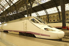 High speed train in station. Front of a sleek, high speed train at a station platform Stock Images