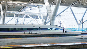 High speed train station in China. Streamlined high speed bullet train arriving at  railway station in China Stock Photography