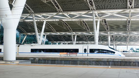 High speed train station in China. Streamlined high speed bullet train arriving at  railway station in China Stock Photo