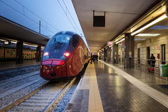 High speed train in station. Naples, Italy - February 13, 2017: Station of Naples Garibaldi, stationary high-speed train on the platform, waiting to leave. Some stock photo