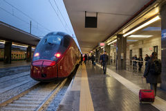 High speed train in station. Naples, Italy - February 13, 2017: Station of Naples Garibaldi, stationary high-speed train on the platform, waiting to leave. Some royalty free stock photography