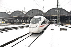 High speed train in station in Wintertime Royalty Free Stock Photography