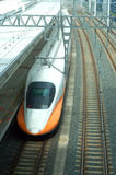 High-speed train stop in. A Streamlined High-speed train stop in the Train station Stock Photo