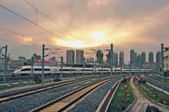 High speed train at sunset. High speed train of China, the streamlined design of a modern bullet train royalty free stock image