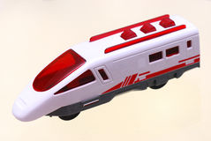 High speed train toy. A photo taken on a the egine car of a high speed rail train against a light yellow backdrop Royalty Free Stock Photos