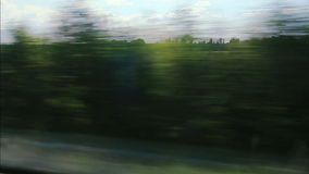 High-speed trains on the fields and lakes (POV) Stock Image