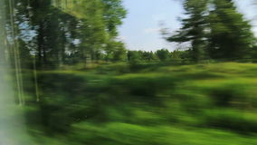 High-speed trains on the fields and woods (POV) Stock Image