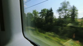 High-speed trains on the fields and woods (POV)