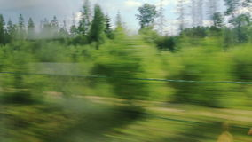 High-speed trains on low forest (POV) Stock Photo