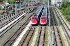 High-speed trains on tracks Royalty Free Stock Photos