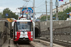 The high-speed tram departs from the subway tunnel stock image