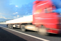 High speed truck. Motion blurred red truck on highway Stock Images