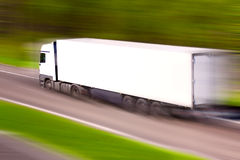 High-speed truck. White truck at high speed Stock Photo