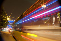 High-speed vehicles blurred trails on urban roads royalty free stock images