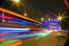 High-speed vehicles blurred trails on urban roads Stock Photo