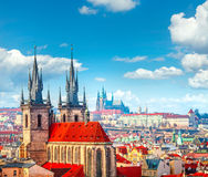 High spires towers of Tyn church in Prague city stock photos