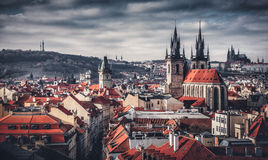 High spires towers of Tyn church in Prague city stock images