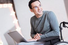 Positive delighted invalid man thinking about future plan Stock Photos