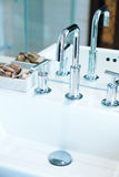 High spout faucet in front of a mirror Stock Images