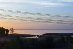 Colorful sunset wires for electric power transmission royalty free stock image