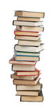 The high stack of books. On a white background Royalty Free Stock Photography