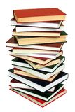 Pile of Books. High stack of books isolated on white background royalty free stock image