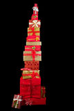 High stack of christmas presents. Beautiful stack of christmas presents with ribbons and bows Royalty Free Stock Images