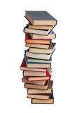 High stack of different books. On a white background stock image