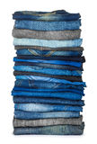 High stack of various shades of blue jeans Royalty Free Stock Photography