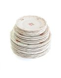 High stack of white dinner plates and saucers iso Royalty Free Stock Photos