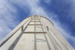 High steel ladder on big water tank Royalty Free Stock Photo
