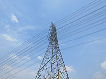 Transmission tower. High steel tower for electric power transmission in sunny day stock photo