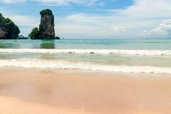 High steep cliff against the turquoise waters of the Andaman Sea Royalty Free Stock Image