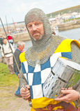 High Steward with sword. Scottish High  Steward in medieval dress holding a sword in his right hand and helmet in the left at the Portsoy Boat Festival on 16th Stock Images