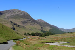 High Stile and Gatesgarthdale Beck Cumbria. England. View west along Gatesgarthdale Beck at the side of the road over Honister Pass in the English Lake District Stock Photos