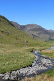 High Stile and Gatesgarthdale Beck Cumbria. England. View west along Gatesgarthdale Beck at the side of the road over Honister Pass in the English Lake District Stock Photography