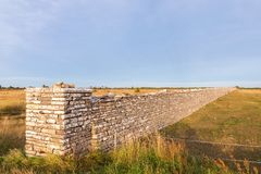 High stone wall Stock Images