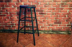 High stool against the background of a red brick wall stock images