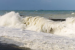 High storm surges. Storm waves on the sea shallows. Stormy weather Stock Image