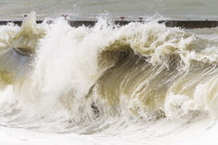 High storm surges. Storm waves on the sea shallows. Stormy weather Royalty Free Stock Images