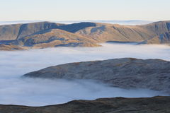 High Street Fells from Catstye Cam. High on the Lakeland tops looking across a temperature inversion that blankets Patterdale and Ullswater below Stock Photos