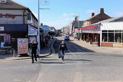 High street, Mablethorpe, Lincolnshire. Mablethorpe, Lincolnshire, UK. October 04, 2018. Holidaymakers and locals shopping and browsing the High street at royalty free stock photography