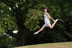 High on success beautiful woman leaping stock image