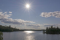 High Sun over a Wilderness Lake Stock Images