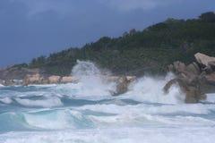 High surf on rocky coast. High surf and waves crashing along rocky coastline Stock Image
