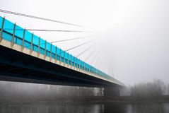 High suspended road bridge in Germany on the river Rhine in the fog. stock photos